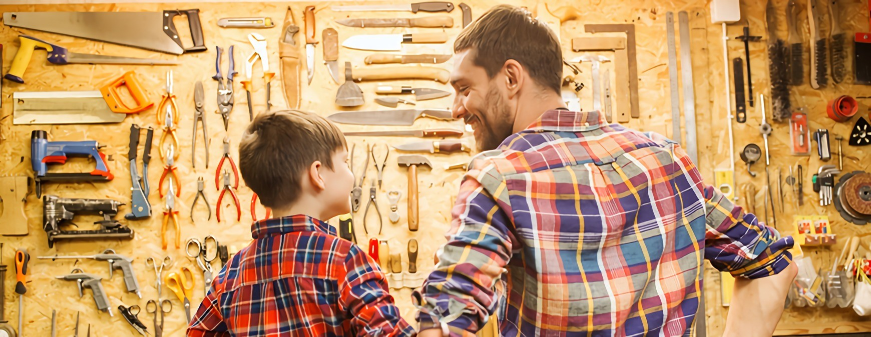 dad and son in workshop
