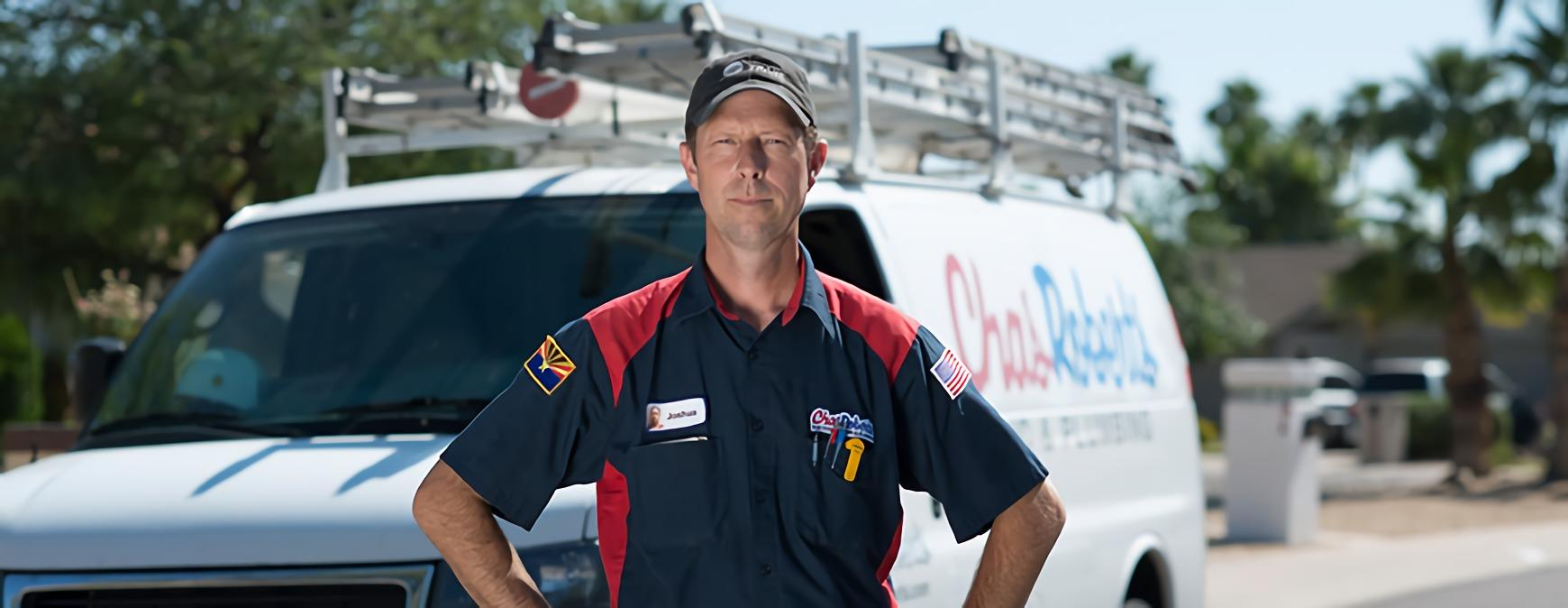 hvac business owner in front of van