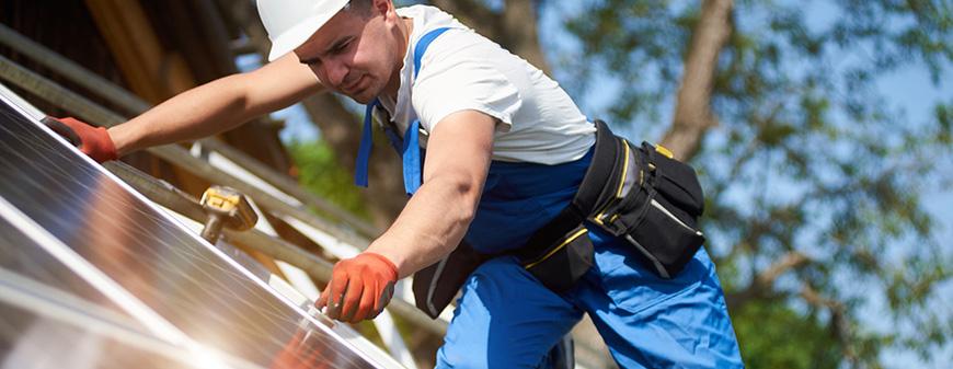 solar panel technician working in sun