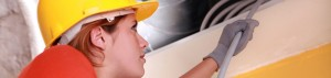 Female HVAC Technician Working