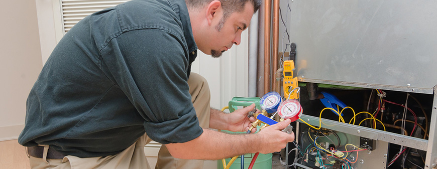 hvac technicial working on ac