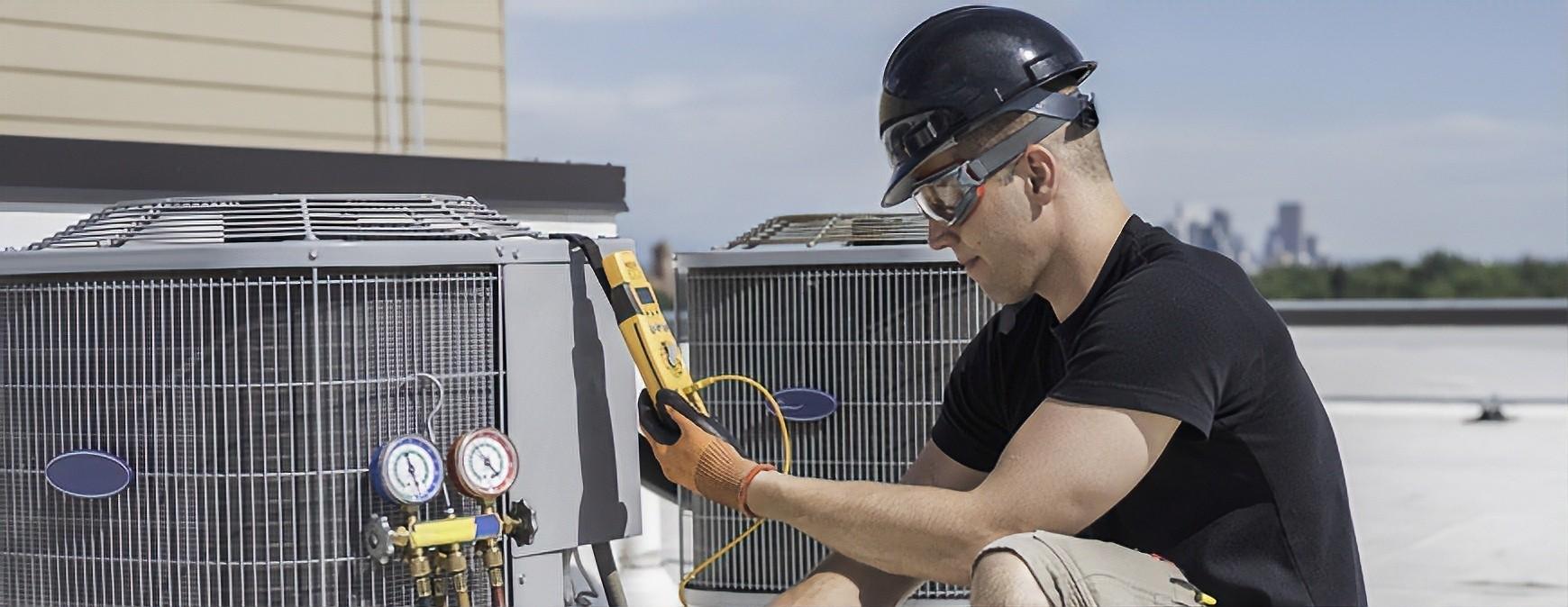 hvac technician checking rooftop ac
