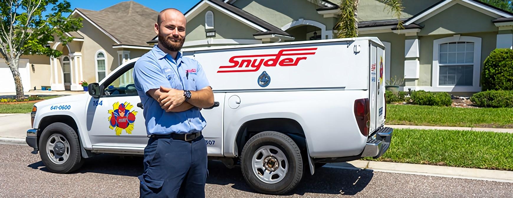 hvac technician in front of work truck