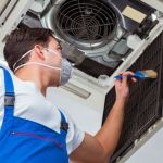 hvac working with face mask during covid