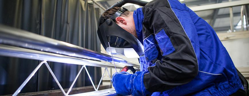 industrial welder working on structure