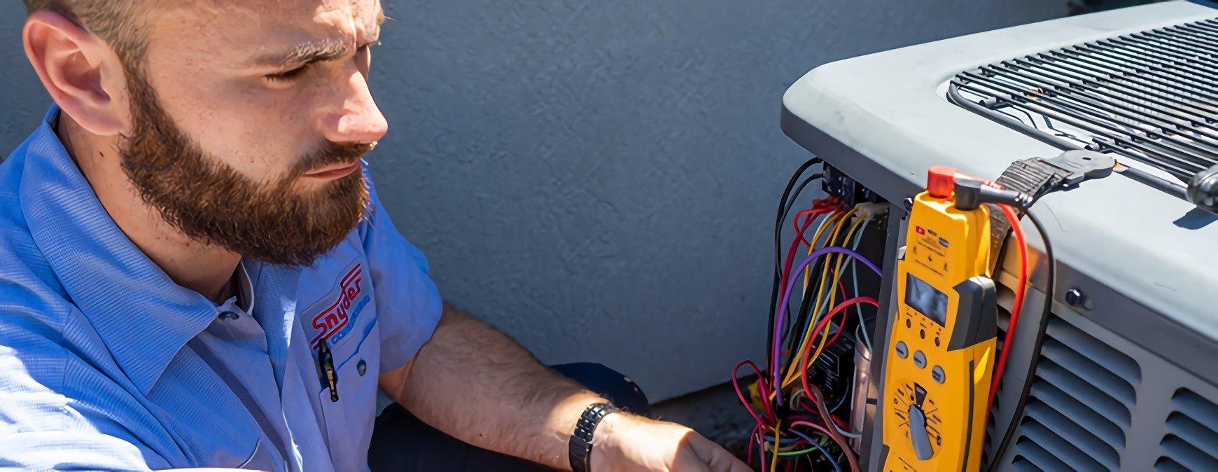 hvac technician working on outside unit